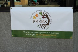 Our logo, designed by Julie, looks great on our new banner.